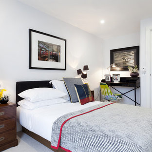 Eclectic guest bedroom photo in London with white walls