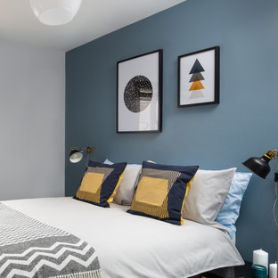 Bedroom - small eclectic guest bedroom idea in Buckinghamshire with gray walls