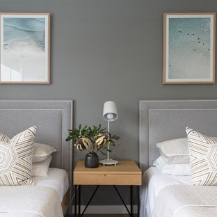 Design ideas for a mid-sized contemporary guest bedroom in Sunshine Coast with grey walls.