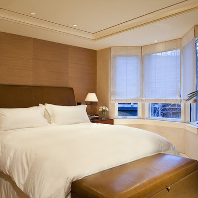 Inspiration for a contemporary bedroom remodel in Denver with beige walls