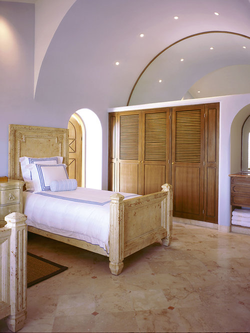 inspiration for a mediterranean marble floor bedroom remodel in mexico city with purple walls - Louvered Bedroom Decor