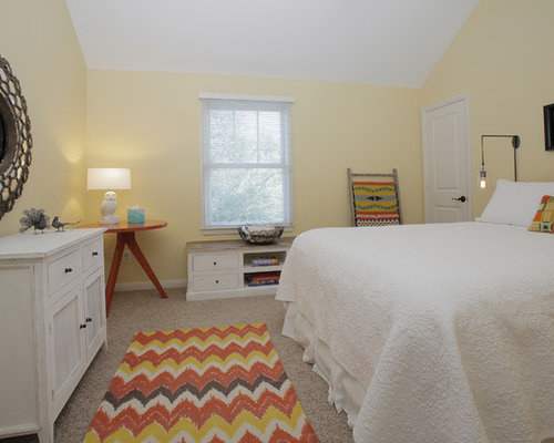 Example of an eclectic bedroom design in Dallas with yellow walls. Soft Yellow Walls   Houzz