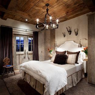 Foto de habitación de invitados rústica con paredes beige