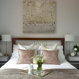 Example of a minimalist guest carpeted and gray floor bedroom design in Essex with gray walls