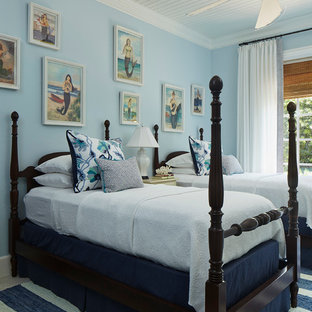 Example of a small beach style guest ceramic tile and beige floor bedroom design in Miami with blue walls and no fireplace