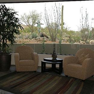 Ejemplo de habitación de invitados contemporánea, de tamaño medio, con paredes grises y suelo de piedra caliza