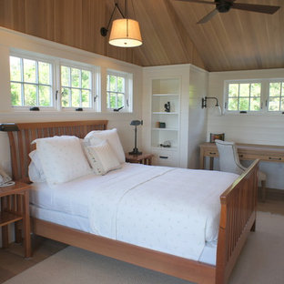 Mountain style light wood floor bedroom photo in Boston with white walls