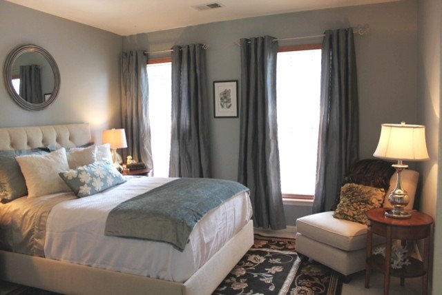light shade of blue gray on the walls allows the darker draperies