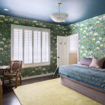 Guest Room with Colorful Wallpaper and Textiles