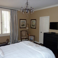 Contemporary Bedroom Guest suite with TV mounted on wall over small dresser