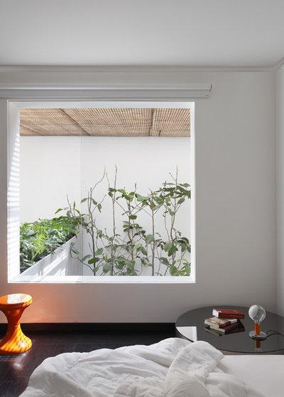 モダン 寝室 by Denilson Machado - MCA Estudio