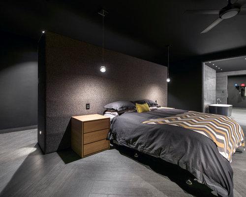 chambre avec un sol en carrelage de porcelaine et un mur. Black Bedroom Furniture Sets. Home Design Ideas