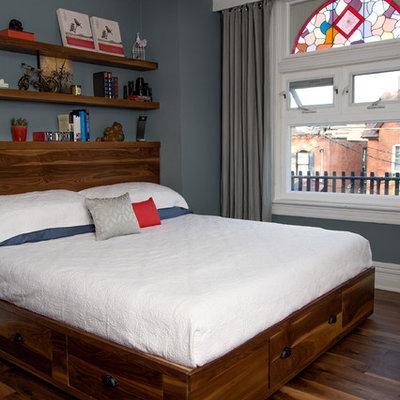 Trendy master dark wood floor bedroom photo in Toronto with blue walls