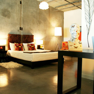 Bedroom - industrial concrete floor and gray floor bedroom idea in Portland
