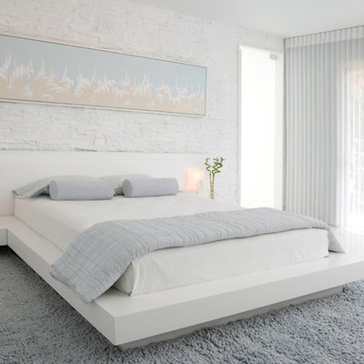 Inspiration for a contemporary white floor bedroom remodel in Atlanta with white walls