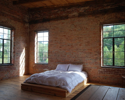 example of an urban bedroom design in atlanta with medium tone hardwood floors - Habersham Furniture