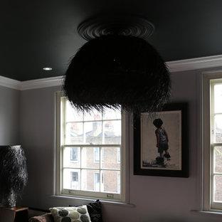 Foto de dormitorio principal, clásico renovado, grande, sin chimenea, con paredes grises, suelo de madera pintada y marco de chimenea de ladrillo