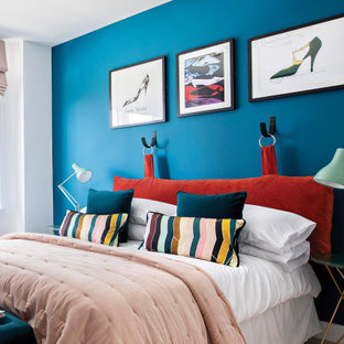Contemporary bedroom in London with blue walls.