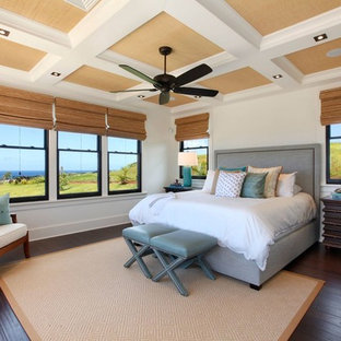 Inspiration for a mid-sized master bamboo floor and black floor bedroom remodel in Hawaii with white walls and no fireplace