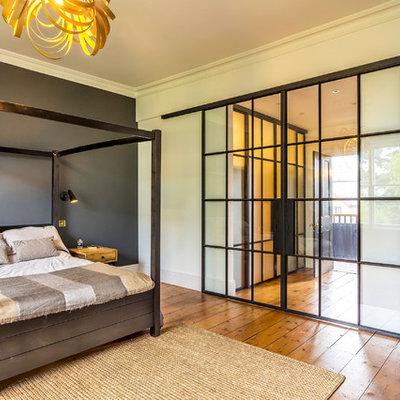 Bedroom - mid-sized contemporary master medium tone wood floor and brown floor bedroom idea in Surrey with multicolored walls
