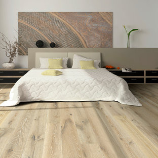 Example of a large trendy master medium tone wood floor and brown floor bedroom design in Los Angeles with white walls