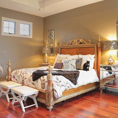 Eclectic medium tone wood floor bedroom photo in Austin with beige walls