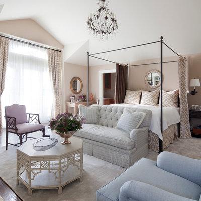 Elegant bedroom photo in New York with beige walls