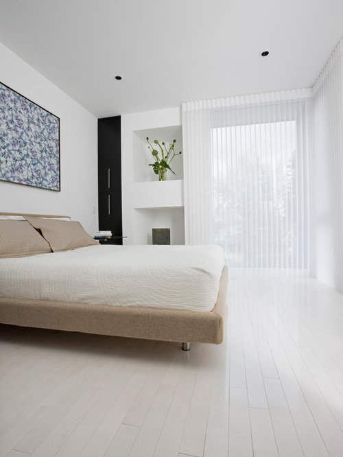 Exceptional Contemporary Painted Wood Floor And White Floor Bedroom Idea In Calgary