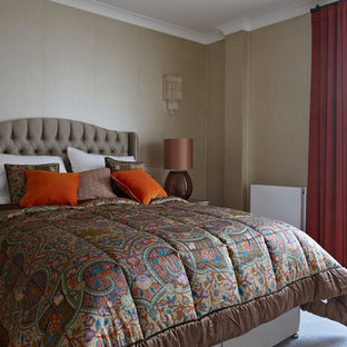 inspiration for a medium sized traditional guest bedroom in surrey with beige walls and grey floors - Beige Bedroom