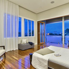 Modern Bedroom by The Building Planners