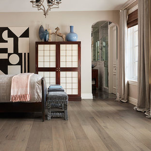 Inspiration for a large transitional guest medium tone wood floor and brown floor bedroom remodel in Phoenix with beige walls and no fireplace