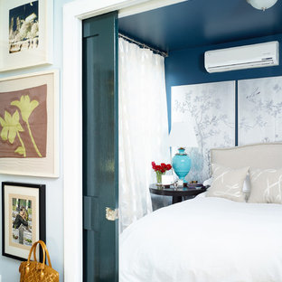 This is an example of an eclectic bedroom in New York with blue walls.