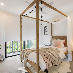 This is an example of a contemporary guest bedroom in Sunshine Coast with beige walls, carpet and beige floor.