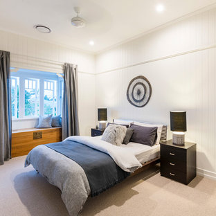 Inspiration for a large transitional guest bedroom in Brisbane with carpet.