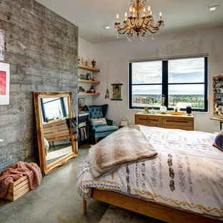 Inspiration for an eclectic concrete floor and gray floor bedroom remodel in Salt Lake City with white walls and no fireplace