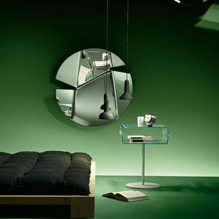 Diseño de habitación de invitados actual, de tamaño medio, con paredes verdes, suelo vinílico y suelo verde