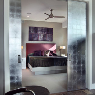 Design ideas for a large contemporary guest bedroom in Grand Rapids with grey walls and carpet.