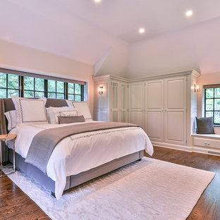 Modelo de dormitorio rústico con suelo de madera oscura