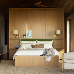 Inspiration for a tropical master bedroom remodel in San Francisco with no fireplace