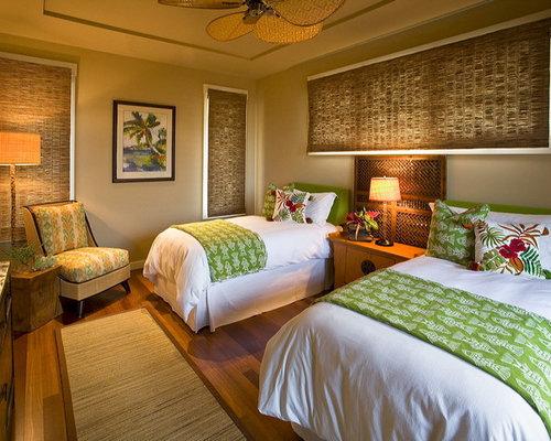 example of an island style guest dark wood floor bedroom design in hawaii with gray walls