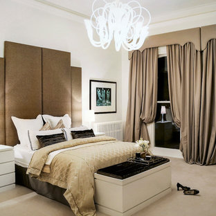 Inspiration for a mid-sized modern master carpeted bedroom remodel in Melbourne with white walls, a standard fireplace and a stone fireplace