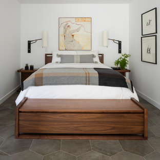 Example of a mid-century modern master porcelain tile and gray floor bedroom design in Seattle with white walls