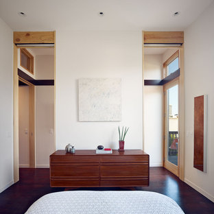 Example of a trendy dark wood floor bedroom design in San Francisco with white walls