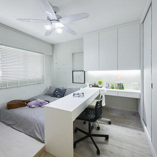 Mid-sized scandinavian guest bedroom in Singapore with white walls and light hardwood floors.
