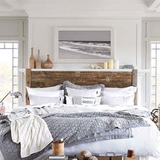 Example of a large coastal guest bedroom design in Minneapolis with white walls