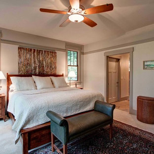 This is an example of an arts and crafts master bedroom in Other with grey walls, carpet and no fireplace.