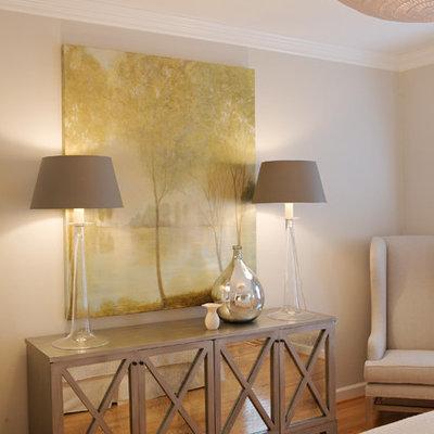 Example of a trendy bedroom design in Raleigh with beige walls