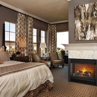 На фото: большая хозяйская спальня в стиле современная классика с коричневыми стенами, ковровым покрытием, стандартным камином, фасадом камина из плитки и коричневым полом с
