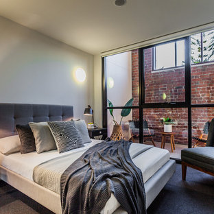 Inspiration For An Industrial Bedroom In Perth With White Walls And Carpet.