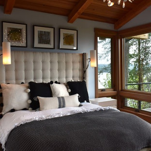 Transitional Medium Tone Wood Floor And Gray Bedroom Photo In Seattle